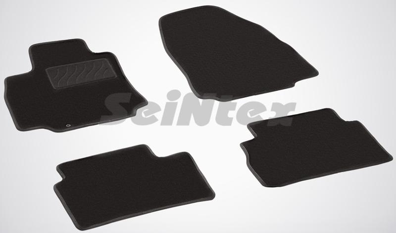 SeinTex 83169 для Nissan Tiida (2007-2013)Nissan<br>- резиновое основание, привлекательный внешний вид, идеальное повторение контуров. Ворсовые коврики LUX от Seintex могут стать идеальным выбором для автовладельцев, которые ценят не только практичность, но и привлекательный внешний вид аксессуаров. Данные коврики имеют резиновую основу, которая не пропускает влагу, а ворсовая часть обеспечивает презентабельный внешний вид аксессуаров. Данные коврики ориентированы на автомобили бизнес-класса и выполнены в универсальном черном цвете. Коврик, предназначенный для водительской стороны, имеет усиленную зону для ног, которая обеспечивает дополнительную прочность и износостойкость. Для того, чтобы коврики надежно прилегали к напольному покрытию и не скользили, их оборудовали специальными шипами с обратной стороны.<br>